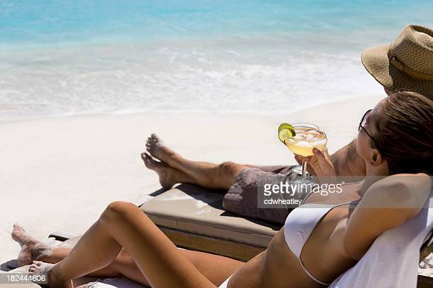 couple with margarita drinks at the beach - margarita drink stock photos and pictures