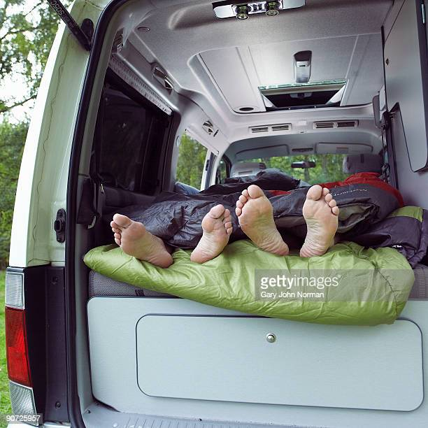 couple with motor home camping - female feet soles stock photos and pictures