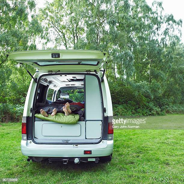 couple with motor home camping - king's lynn stock pictures, royalty-free photos & images