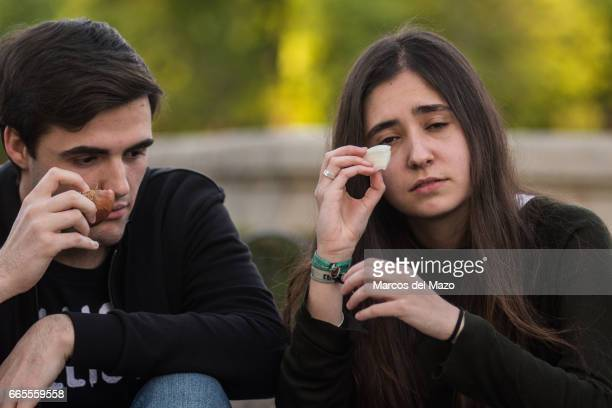 A couple with onions trying to cry during an event organized through Facebook under the name 'Gathering for crying' celebrated in the Retiro Park