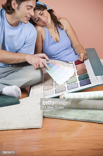 Couple with paint and carpet samples