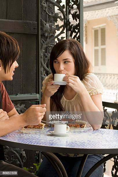 Couple with pie and coffee at outdoor cafe