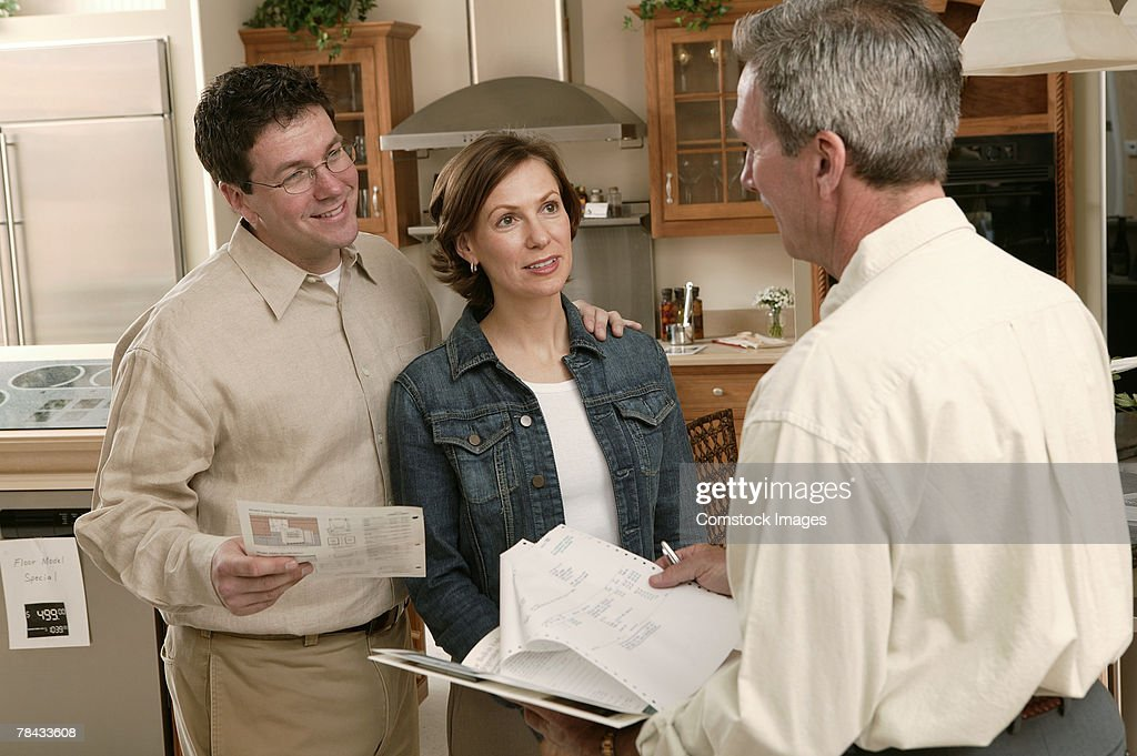 Couple with salesman in home improvement store : Stockfoto