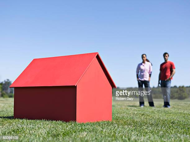 Couple with small model house