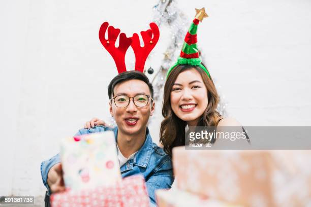 Couple with smile on their face distributing gifts.