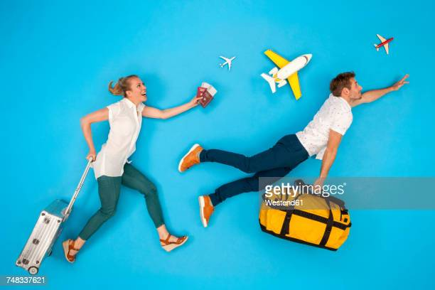 Couple with suitcases hurrying to to get their flight