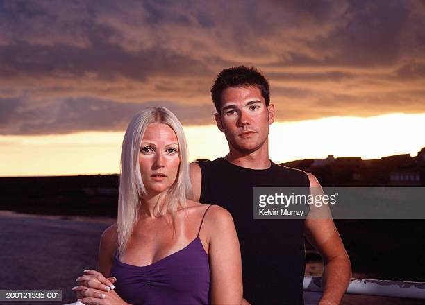 couple with sunburn, outdoors, dusk, portrait - idiots stock pictures, royalty-free photos & images