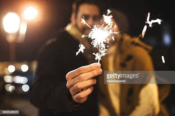 couple with the sparkler for the new year