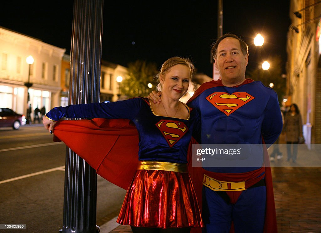 A couple with the Superman and Supergirl costume stroll around the Georgetown neighborhood during Georgetownu0027s annual  sc 1 st  Getty Images & A couple with the Superman and Supergirl Pictures   Getty Images