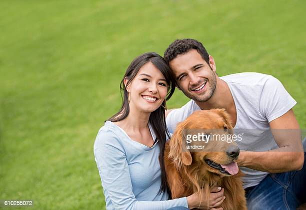 Couple with their dog at the park