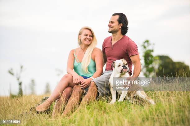 Couple with their dog enjoying outdoors.