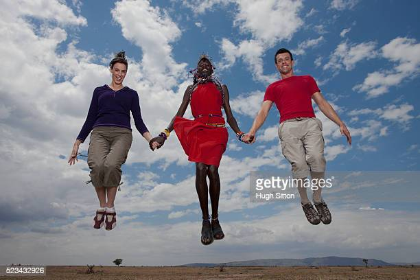 couple with tribesperson - hugh sitton stock pictures, royalty-free photos & images