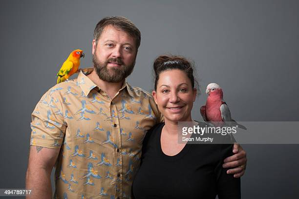 Couple with Tropical Birds on Shoulders