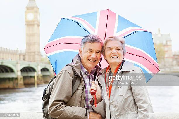 Couple with umbrella, in front of Big Ben.