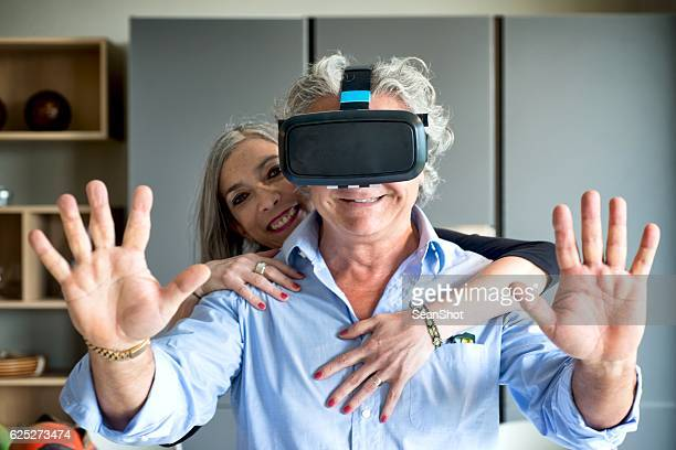 couple with virtual reality glasses - a sense of home stock photos and pictures