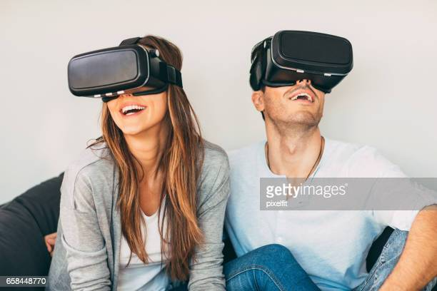 Couple with virtual reality headsets