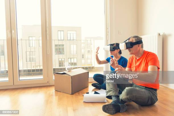 Couple with VR headset moving home