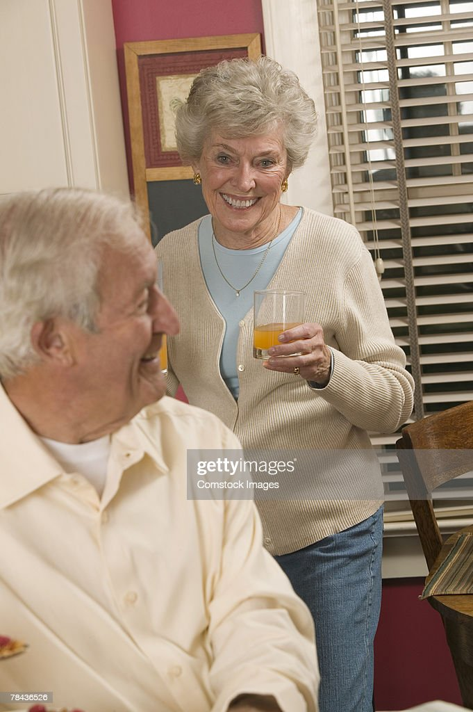 Couple with woman drinking juice : Stockfoto