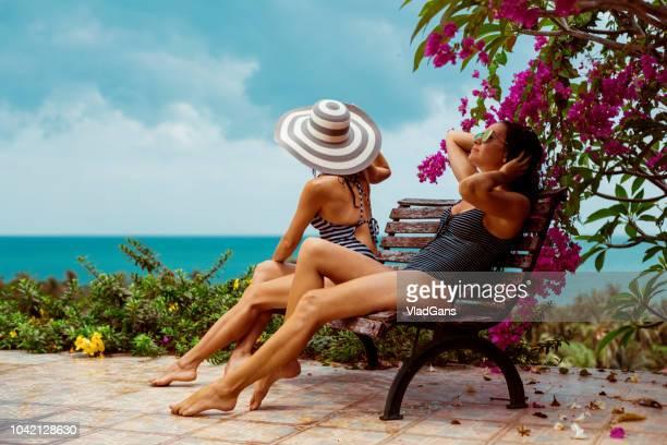 Couple woman near the swimming pool