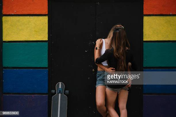 couple women kissing on the street in madrid city - bisexuality stock pictures, royalty-free photos & images