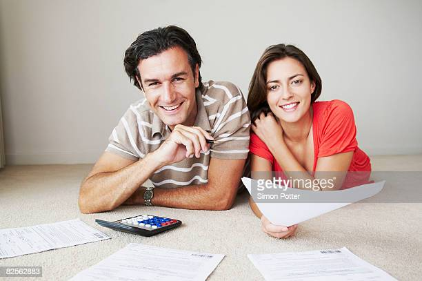 couple work on home finance - fun calculator stock photos and pictures