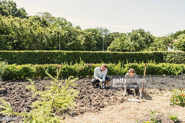 Couple working at community garden