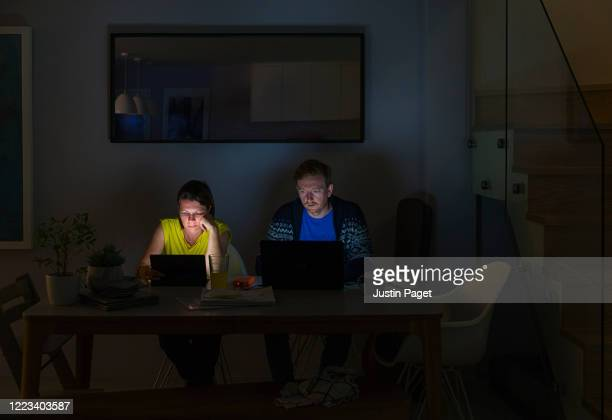 couple working from home late at night - makeshift stock pictures, royalty-free photos & images