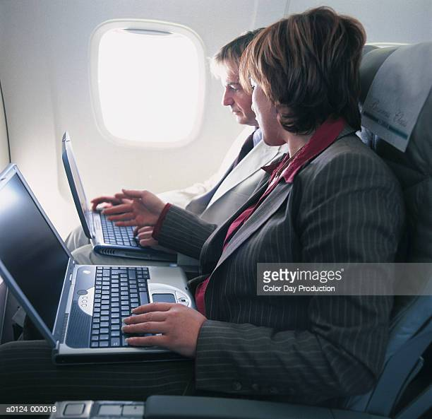 Couple Working in Airplane