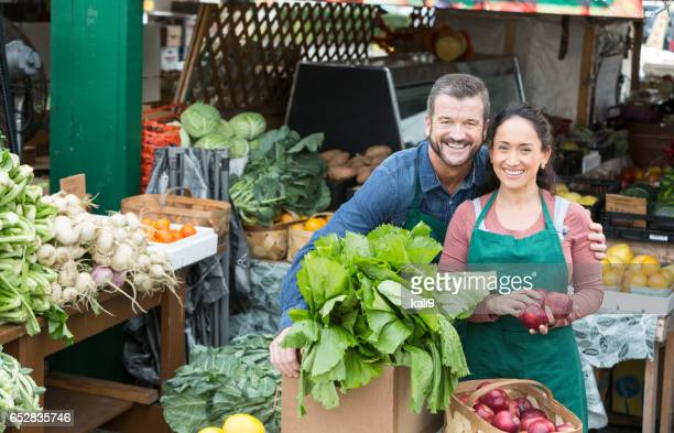 Couple working in fruit and vegetable stand