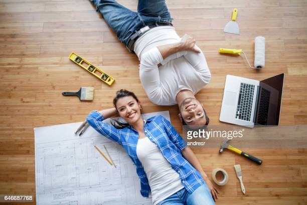 couple working on a housing project - council flat stock pictures, royalty-free photos & images