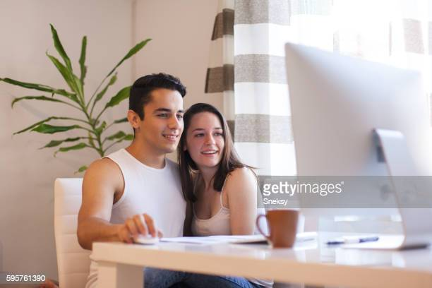 Couple working on computer together