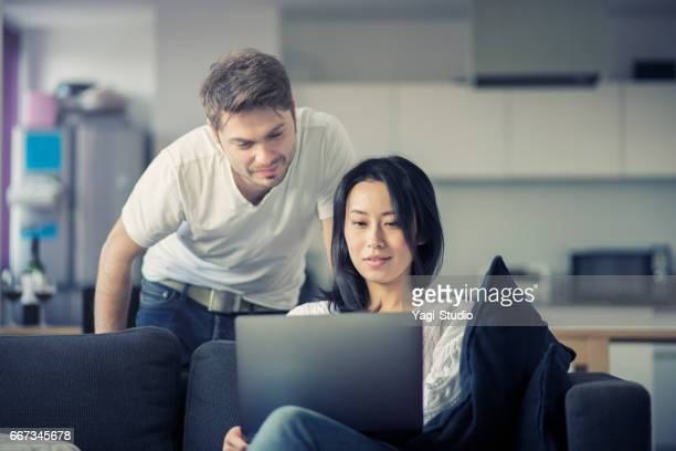 Couple working on laptop in home