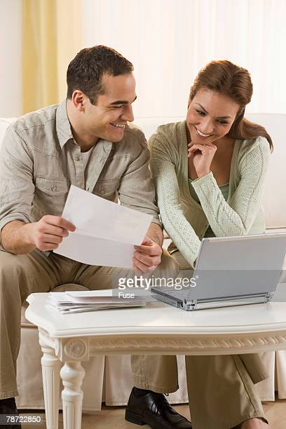 Couple Working on Laptop Together