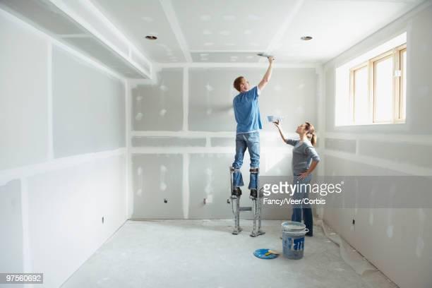 Couple working on room