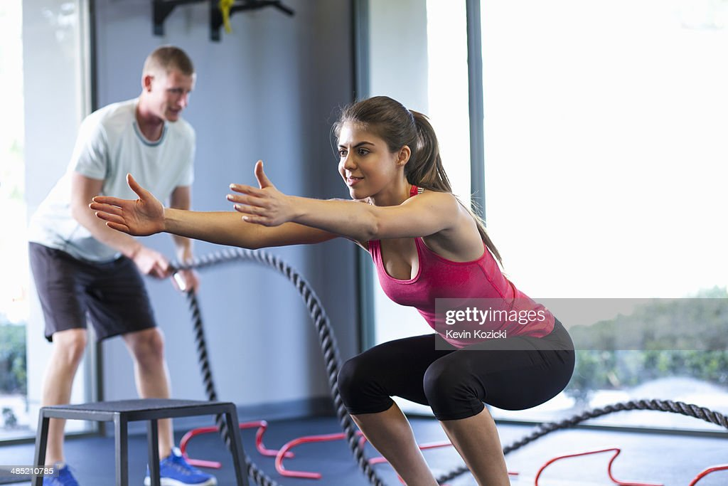 Couple working out in gym : Stock Photo