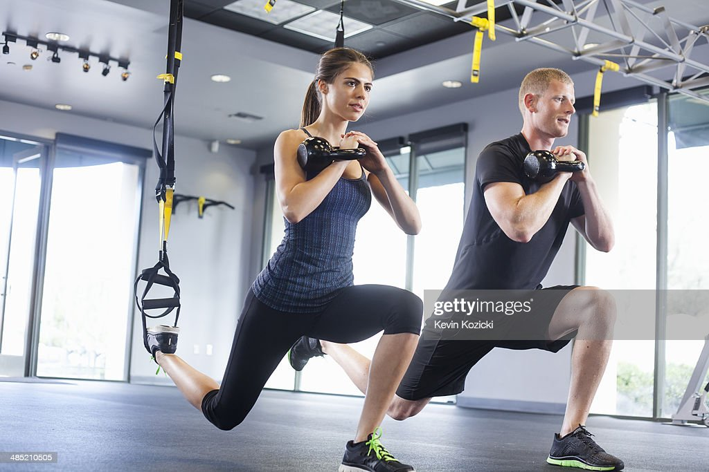 Couple working out with weights : Stock Photo