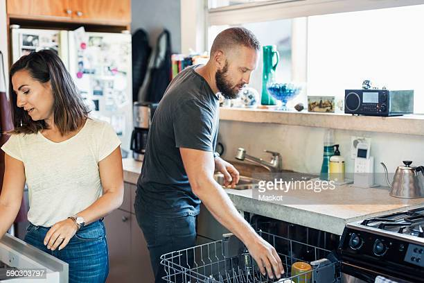 Couple working together in kitchen