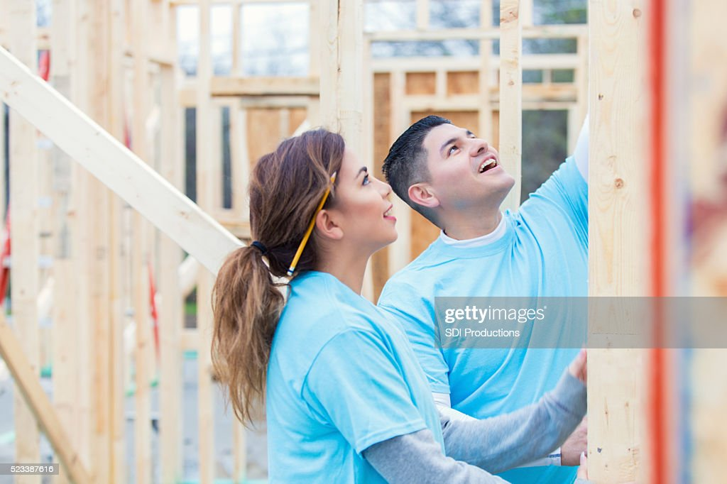 Couple working together to build home for charity : Stock Photo