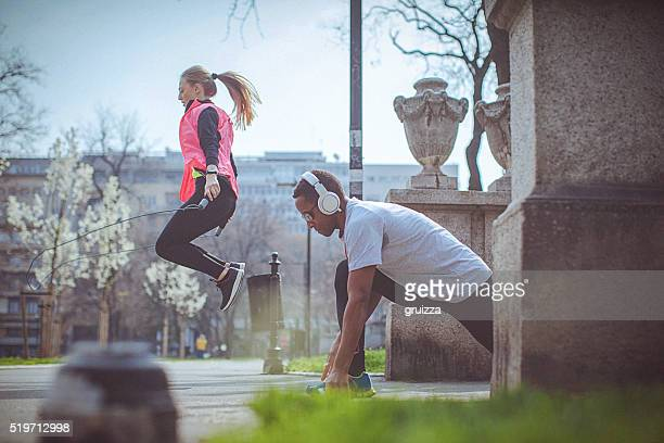 Couple work-out together in the city park