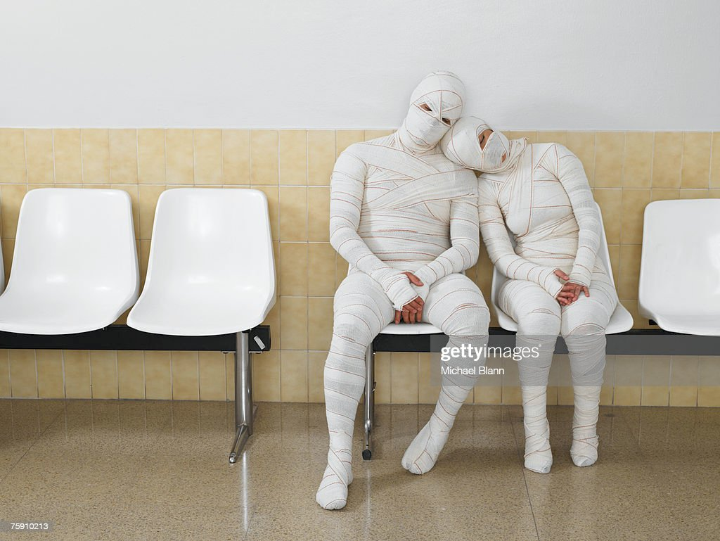 Couple wrapped in bandages leaning together : Stock Photo