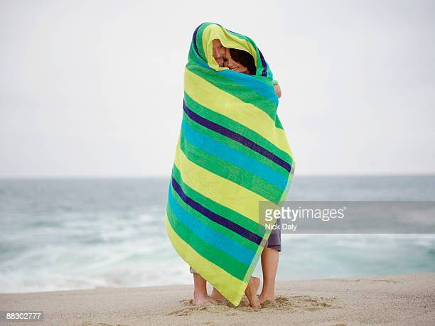 Couple wrapped up in colorful towel