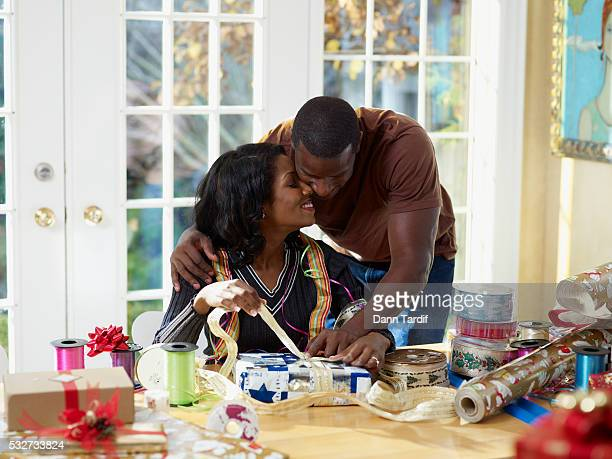couple wrapping christmas presents - african american christmas images stock pictures, royalty-free photos & images