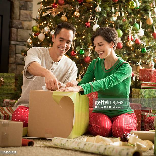 couple wrapping presents for christmas - orem utah stock pictures, royalty-free photos & images