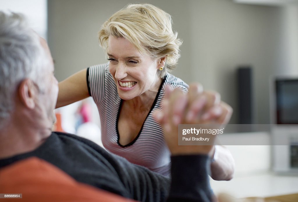 Couple wrestling on sofa : Stock Photo