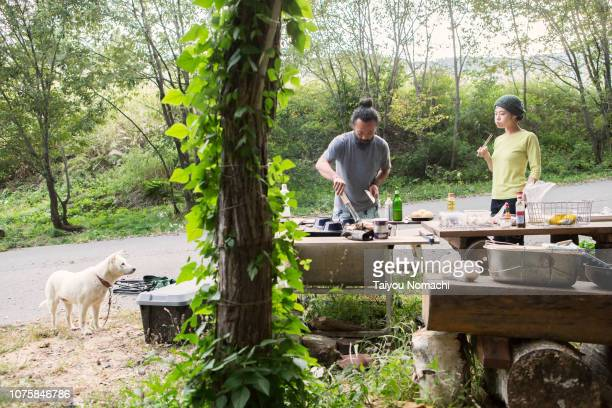 Couples and dogs enjoying barbecue