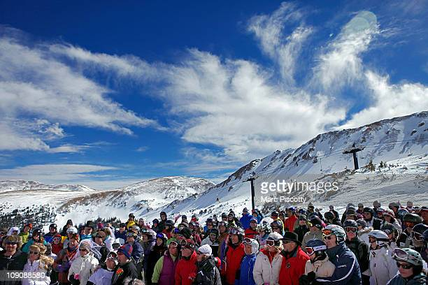 Couples and wellwishers listen on atop Loveland Ski Area in Colorado at the 20th Annual Marry Me Ski Free Mountaintop Matrimony on Valentine's Day...