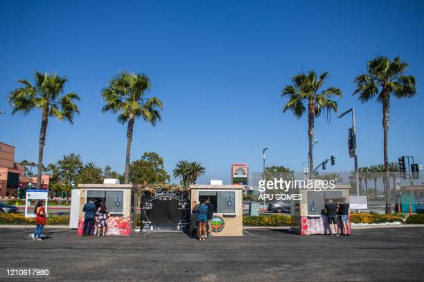 TOPSHOT Couples are married by clerk recorders at the Honda Center parking lot on April 21 2020 in Anaheim California The County of Orange Clerk...