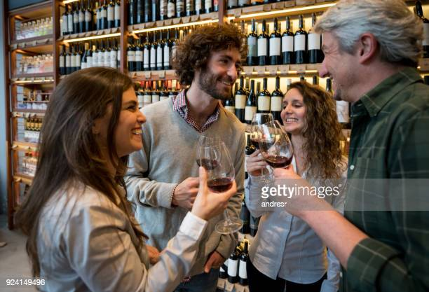 couples at a winery tasting wines looking very happy and smiling - bar drink establishment stock pictures, royalty-free photos & images