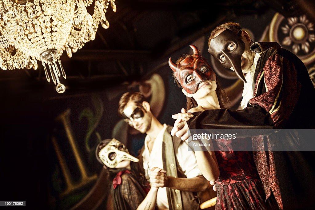 Couples at the masquerade ball : Stock Photo