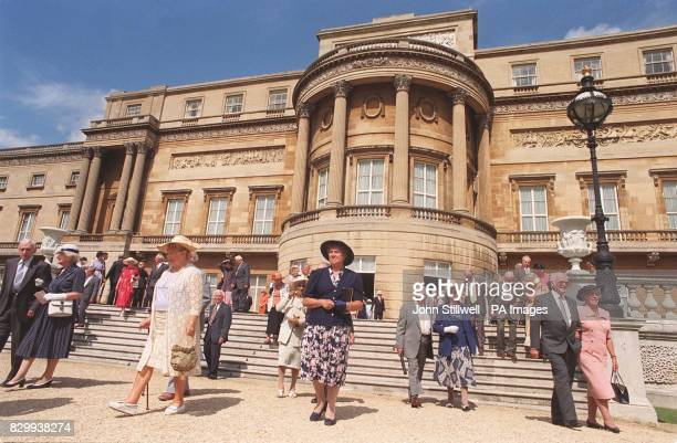 Couples celebrating 50 years of marriage walk into the garden at today's special Golden Wedding Anniversary garden party given by the Queen and Duke...